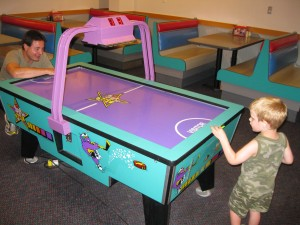Dylan and Lukas Playing Air Hockey